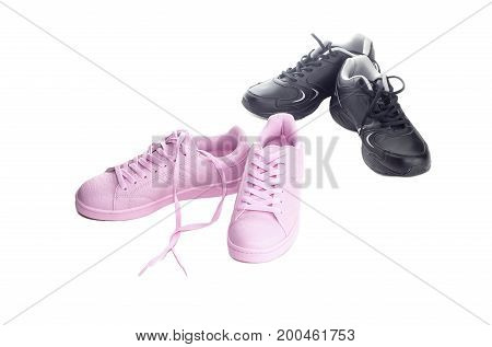 Pink women and black men's shoes on a white background closeup