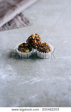Natural useful raw sweets from dates pistachios peanuts and cranberries in a nut shell