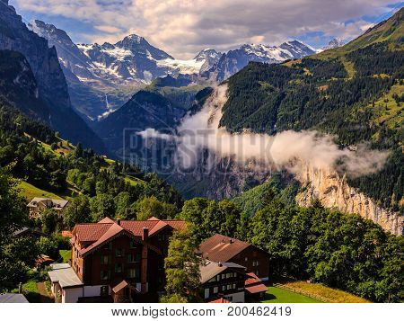 Lauterbrunnen valley in the Bernese Alps in summer on a cloudy day. Seen from Wengen Bernese Oberland Switzerland