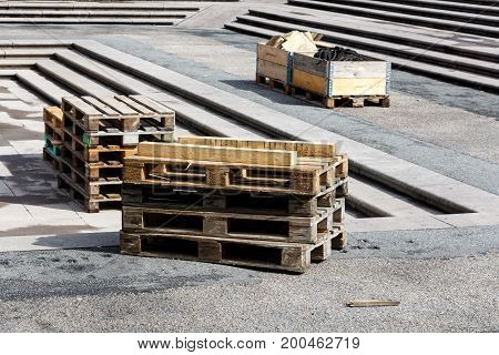 Stacks of Wooden pallets for industrial transportation by trucks