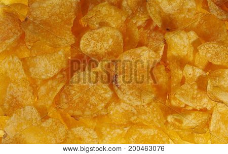 full frame background of potato chips seen from above