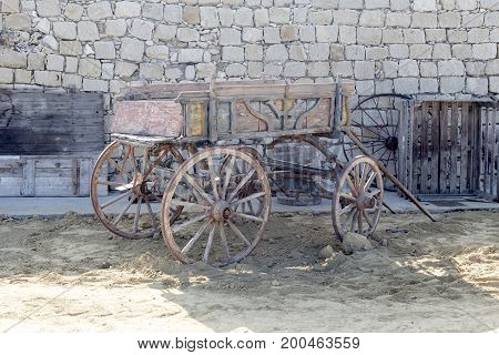 The old, wooden horse carriage closeup outdoors