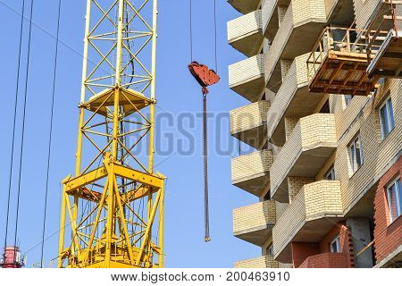 New residential building construction in process. Unfinished multi storey building.