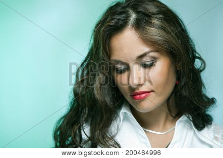 Portrait of beautiful sorrowful brunette caucasian woman
