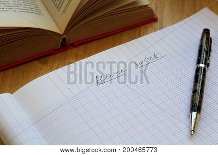 copybook with writing home work on the table