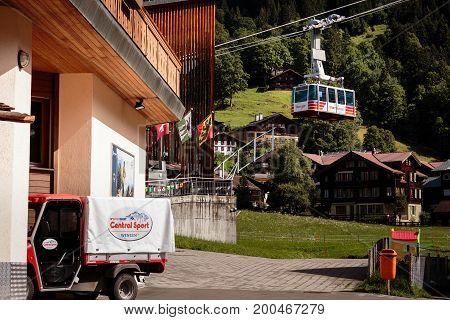 Wengen Bernese Oberland Switzerland - JULY 31 2017 : Wengen Mannlichen Aerial Cableway leaving basestation in Wengen
