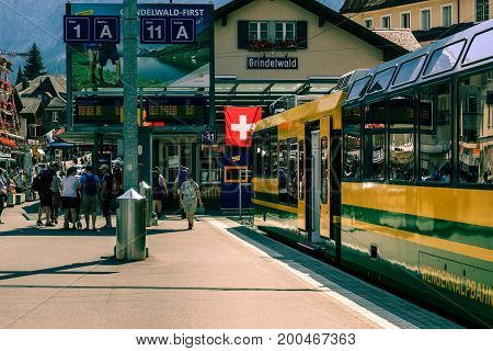 Grindelwald Bernese Oberland Switzerland - AUGUST 1 2017 : Yellow - Green train from the Wengernalpbahn in the Grindelwald railway station
