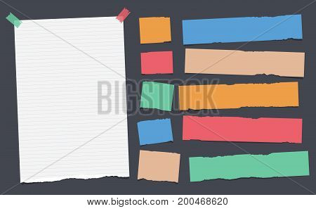 Colorful, ripped, note, copybook, notebook paper strips stuck with sticky, adhesive tape on black background