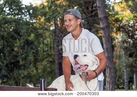 Teenager Boy Walks With His Dog In The Park
