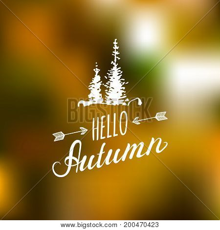 Vector hand lettering inspirational typography poster Hello autumn with spruces silhouettes on blurred background.