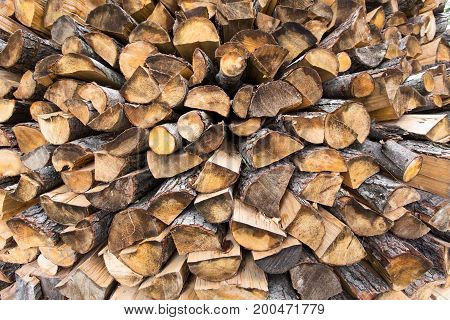 firewood stacked birch oak pine. Horizontal image