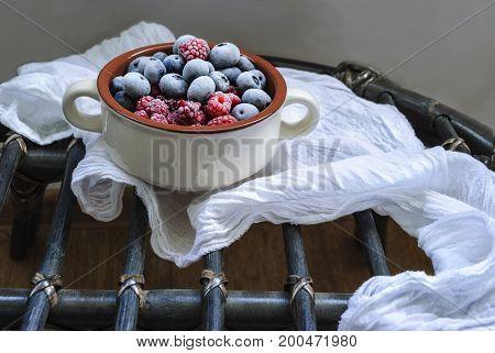 Bowl of frozen berries , blueberries and raspberries