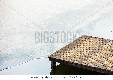 Wooden Bridge Platform On Frozen Water