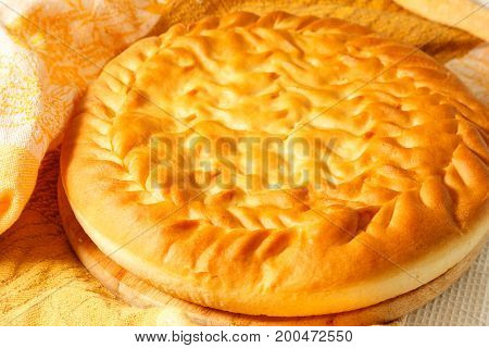 Round Pie With Filling On A Table