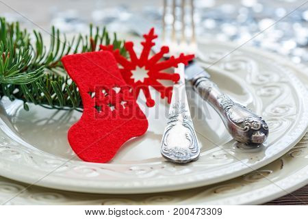 Red Christmas Decor And Cutlery On The Plate.