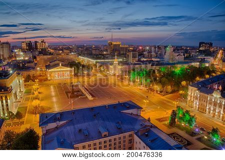 Evening summer cityscape from rooftop. Lenin Square, Voronezh downtown theater