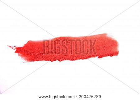 Lipstick smear sample on white background. red