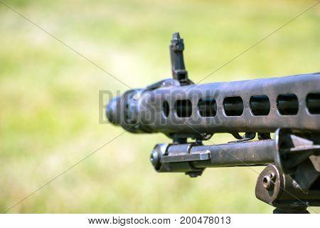Selective focus. The barrel of a machine gun close-up