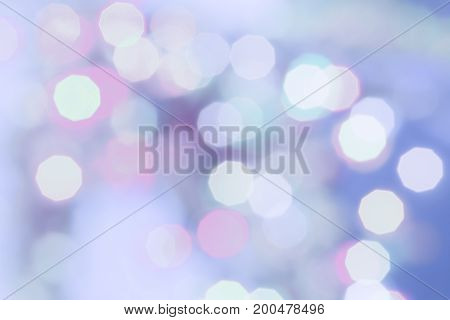 Purple colored Christmas bokeh light abstract holiday background