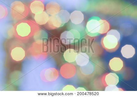 Soft colored Christmas bokeh light abstract holiday background