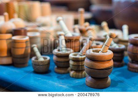 Handmade wooden mortars in market on medieval festival