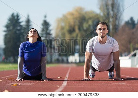 Attractive Couple Stretching Before Fitness And Exercise