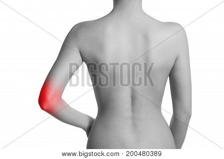 Woman having pain in her elbow. Elbow is highlighted by red colour.