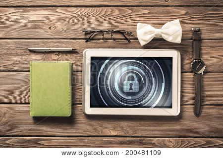 Men's accessories and tablet with security concept on screen