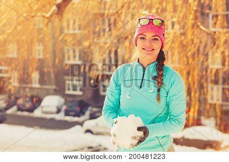 Girl With Snow In City.