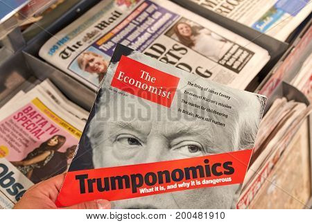 LONDON ENGLAND - MAY 14 2017 : The Economist magazine with Donald Trump on title page. The Economist is an English-language weekly magazine-format newspaper owned by the Economist Group.