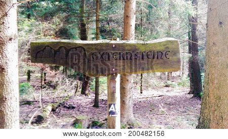 Wooden sign for Externsteine amongst the trees in Germany