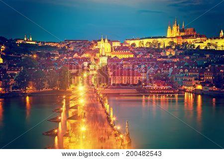 View of Charles Bridge Prague Castle and Vltava river in Prague Czech Republic during blue hour. The world famous Prague and Europe landmark