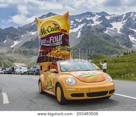 Col du Lautaret France - July 19 2014: The vehicle of Mc Cain during the passing of the advertising caravan on mountain pass Lautaret during the stage 14 of Le Tour de France 2014. Before the appearance of the cyclists there is a caravan of advertising ca
