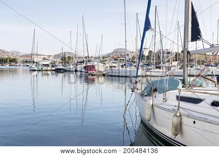 Yachts moored on the waterfront in port (Greece, island Salamis)