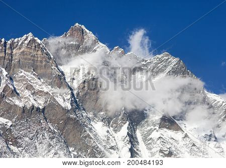 Top of Lhotse with clouds on the top - way to mount Everest base camp Khumbu valley Sagarmatha national park Nepalese Himalayas