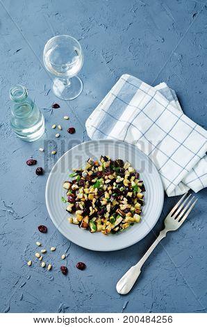 Eggplant pine nuts parsley dried cranberries salad