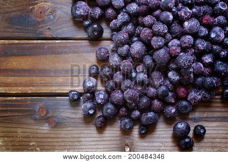 Blueberries on wood with copy space. Top down view.