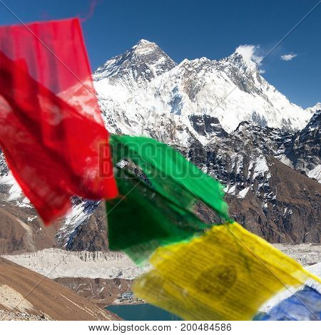 view of Mount Everest and Lhotse with buddhist prayer flags from Gokyo Ri - way to Everest base camp Sagarmatha national park Khumbu valley Solukhumbu Nepal Himalayas