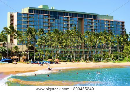 August 1, 2017 in Kauai, HI:  Marriott Hotel Resort at Kalapaki Bay surrounded by a sandy beach with Palm Trees taken on the Hawaiian Coast where guests can sunbathe on the beach or swim and surf in the ocean taken at Lihue in Kauai, HI