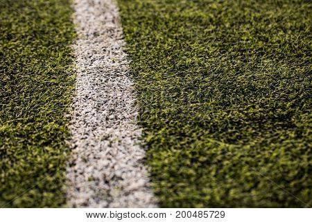green grass pattern for football sport, Football field, soccer field, team sport texture. White stripe on it. Close up focus