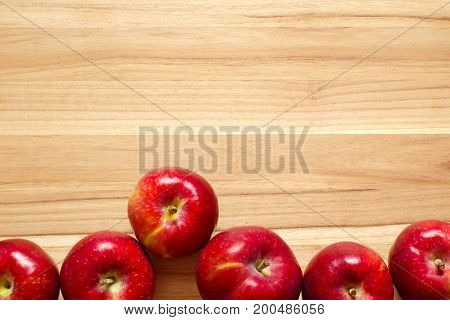 Apples on wood. Top down view with copy space.
