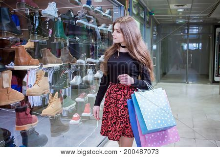 young lady shopper in mall, woman at shopping