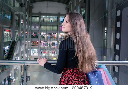 woman watching on shops in big mall