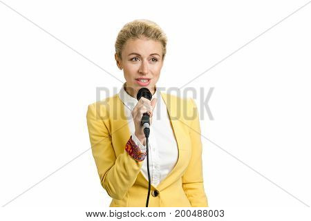 Young business woman speaking on microphone. Beautiful business woman is speaking on conference, white background.