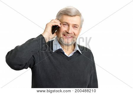 Portrait of mature man talking on phone. Portrait of mature man having wrinkles and grey hair dressed in casual wear holding smartphone.