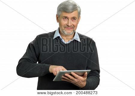 Mature man using computer tablet. Senior man with digital tablet on white background close up.