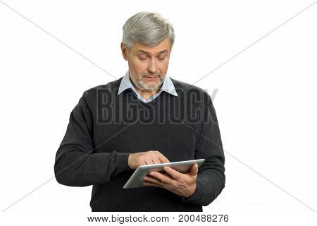 Confused mature man with pc tablet. Puzzled older man working on computer tablet on white background. Senior man with digital computer looking confused.