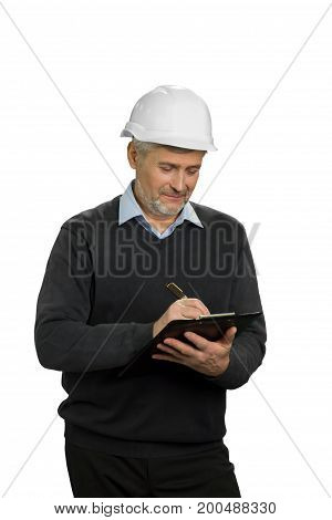Building inspector checking the object. Mature engineer writing on clipboard, white background.