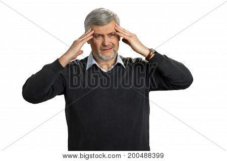 Mature man getting headache, white background. Tired senior man have a terrible headache. Overworked elderly enterpreneur have migraine.
