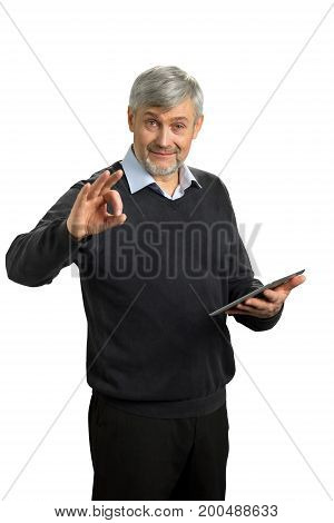 Handsome mature man showing Ok sign. Elderly man with digital tablet showing gesture ok on white background.